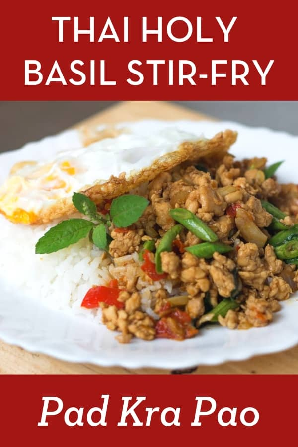 A popular Thai dish you can find at any Thai restaurant, but homemade is better! Chicken stir-fry with holy basil, topped with a fried egg. Quick, easy, weeknight friendly recipe! #thaifood #thaistreetfood #hotthaikitchen #chickenstirfry #thairecipe