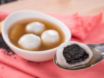 A classic dessert in Chinese and Thai cuisines. A sweet, nutty black sesame filling enrobed by a mochi-like chewy, soft dough, steeped in soothing ginger tea. It's the perfect no-bake dessert for the winter! #dessert #chinese #glutenfree #vegan #nobake #asiandessert
