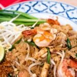 "A pinterest image of pad thai shrimp with text that says ""authentic pad thai"""