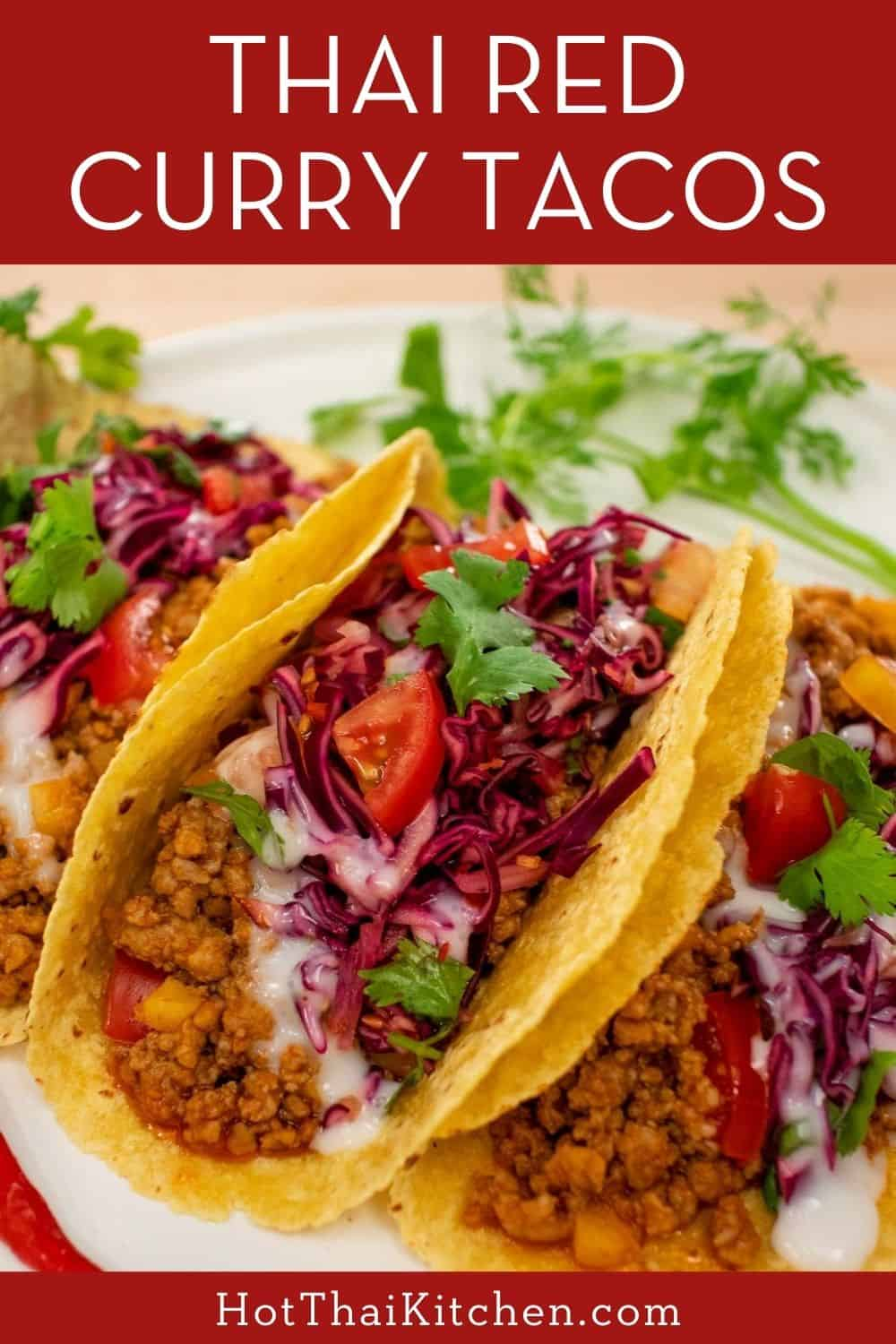 Unbelievably delicious Thai-inspired tacos filled with ground meat flavoured with red curry paste, topped with a crunchy Thai cabbage slaw and coconut crema. #thairecipe