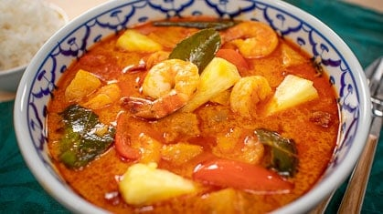 A bowl of pineapple curry with shrimp