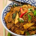 A bowl of Thai glass noodle stir-fry with baby corn and Thai eggplant