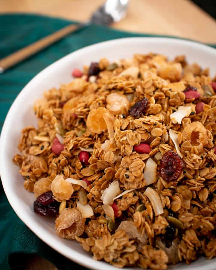 A bowl of granola with dried longans, cranberries, peanuts and coconut