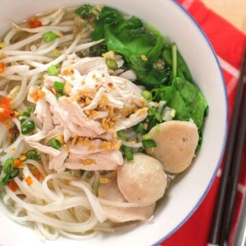 A bowl of Thai chicken noodle soup