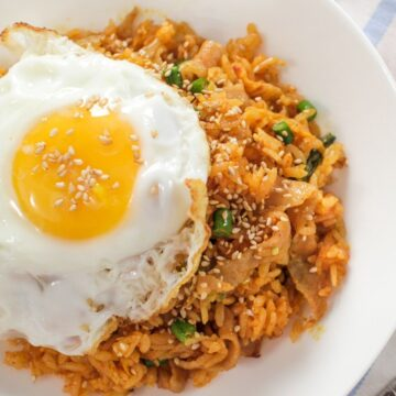 A plate of kimchi fried rice with fried egg on top