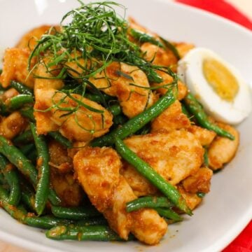 A plate of chicken and long bean stir-fry