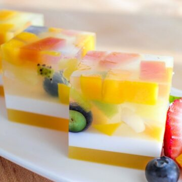 Cubes of agar jelly with fruit embedded inside on a white plate