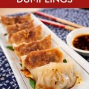 "A pinterest image of gyoza with text saying ""Pork and Cabbage Dumplings"""