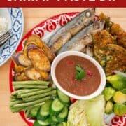 "A platter of shrimp paste dip, steamed vegetables, omelette, and mackrel with text overlay ""Umami Thai Sheimp Paste Dip"""