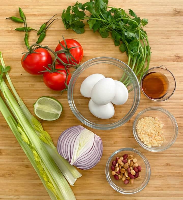Ingredients for making fried egg salad.