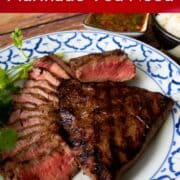 """A plate of grilled steaks, some thinly sliced. With text overlay """"The ONly Steak Mainade You Need"""" and """"HotThaiKitchen.com"""""""